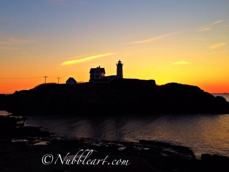 An image of Nubble Light at sunrise.