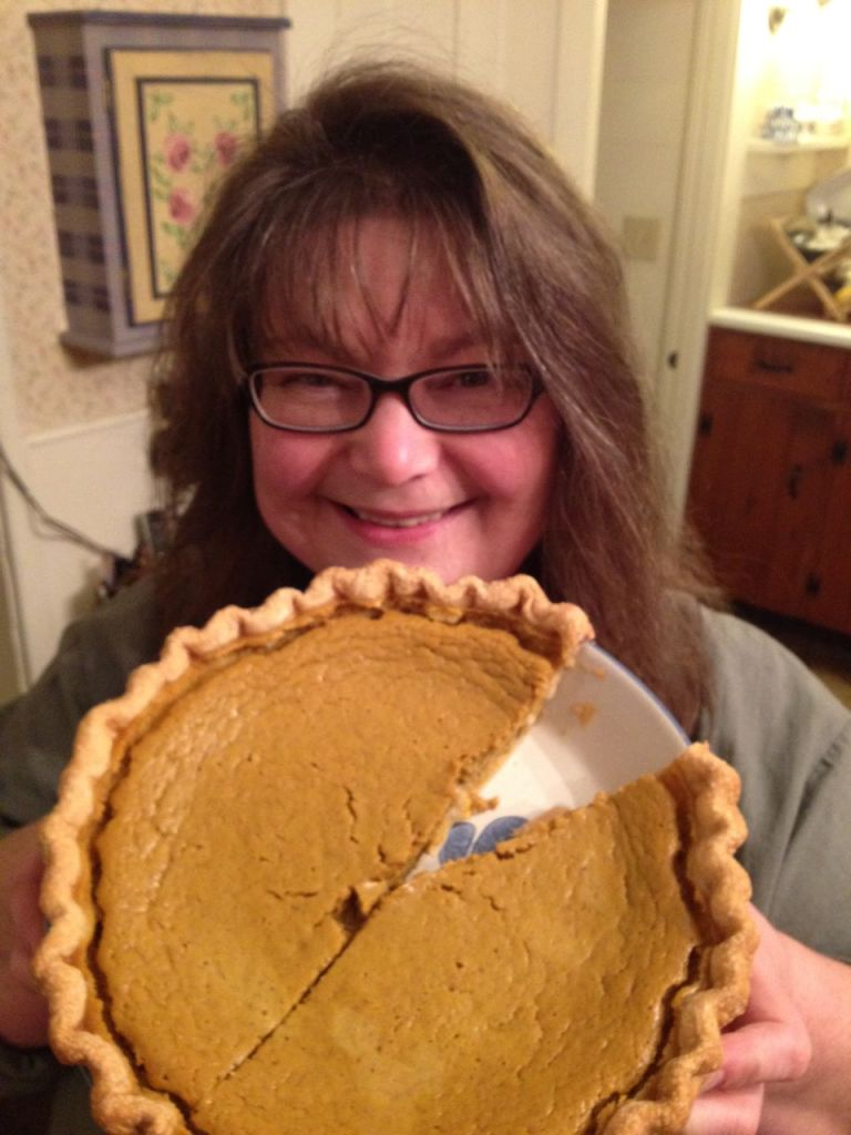 Here is my Aunt PJ and her Squash Pie she made last Christmas Eve for my family's holiday celebration.