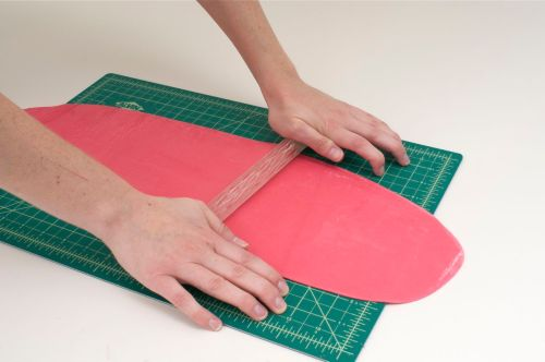 Using a textured rolling pin and even pressure, carefully roll out a raised design.