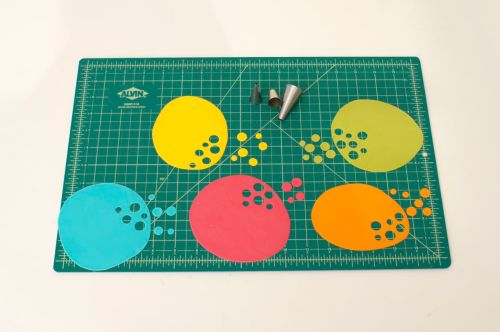 To make confetti, roll out sugar paste and cut out circles using piping tips.  Allow to dry.