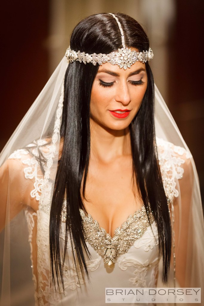 Larry Vrba designed Elyses's head piece, top of her bridal gown and her cuff.
